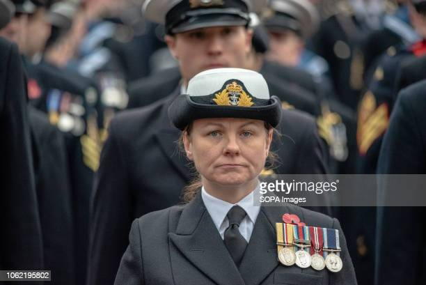 A female member of the Armed Forces is seen in rank with her colleagues at a remembrance day parade in George Square Glasgow Members of the UK armed...