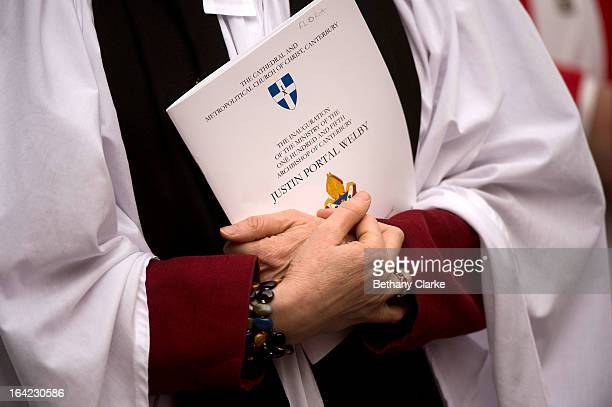 A female member of the clergy holds an order of service for the Inauguration of the Ministry of Justin Welby as Archbishop of Canterbury at...