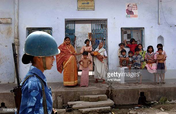 A female member of the Indian Rapid Action Force conducts a flag march March 14 2002 through the streets of the disputed northern Indian city of...