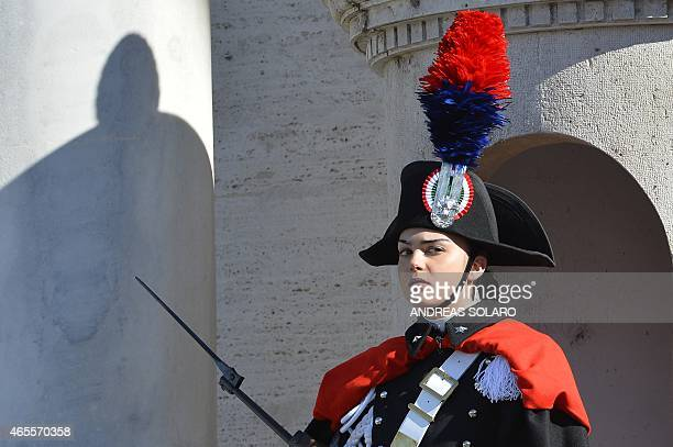 A female member of the Italian Presidential Honor Guard stands at the entrance of the Quirinale Palace the Italian Presidential palace on the...