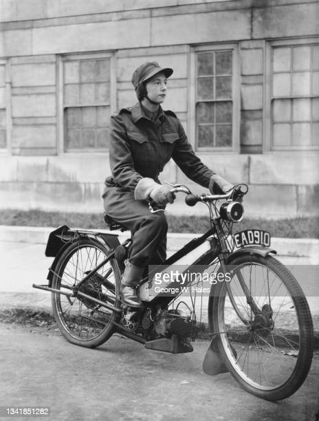 Female member of the Mechanised Transport Corps sits astride an Excelsior Autobyk de Luxe powered by the Villiers Junior De Luxe engine on 19th...