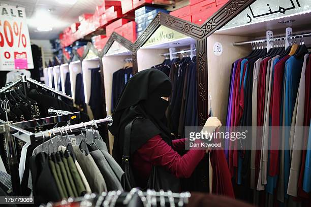 A female member of the Muslim community makes a last minute purchase for Eid on the last day of Ramadan on August 7 2013 in London England The holy...