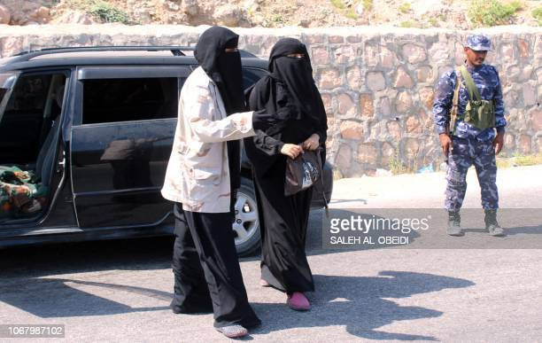 A female member of the Yemeni security forces leads away a woman to inspect her bag in privacy at a checkpoint in the former AlQaeda in the Arabian...