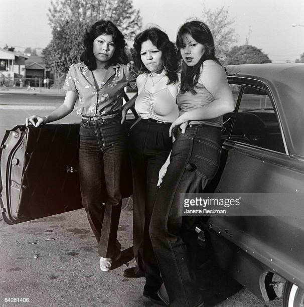 Female members of a Mexican gang standing next to a car in East Los Angeles 1983