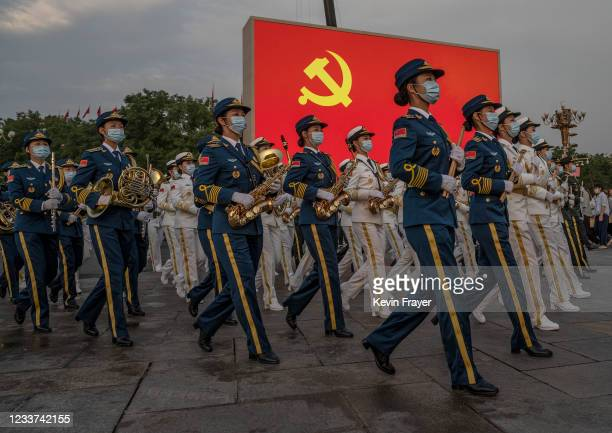 Female members of a People's Liberation Army ceremonial band march at a ceremony marking the 100th anniversary of the Communist Party on July 1, 2021...