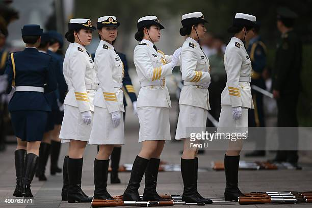Female members of an honor guard prepare during a rehearsal before a welcome ceremony for Portuguese President Anibal Cavaco Silva held by Chinese...