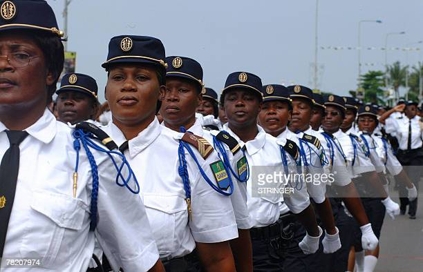 Female members of Gabon's national police force parade in the streets of Libreville 02 December 2007 to mark the 40th anniversary of President Omar...