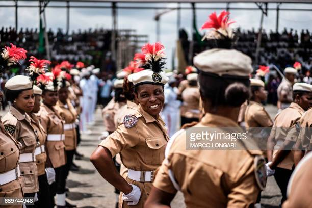 TOPSHOT Female members of Nigerian military forces march in front of authorities and members of the public during a Democracy Day parade on May 29...