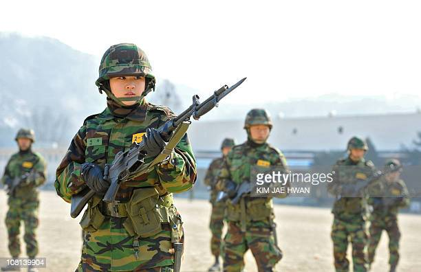 Female members of South Korea's Reserve Officer Training Corps join a bayonet drill at the Army Cadet Command camp in Seongnam south of Seoul on...