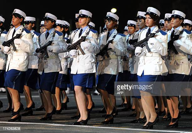 Female members of the Algerian police forces parade during a ceremony marking the fiftieth anniversary of the General Directorate of National...