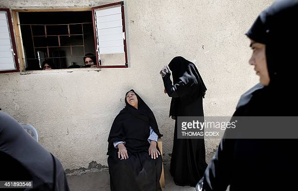 Female members of the al-Kaware family grieve during the funeral for 7 killed members of the family in Khan Yunis, in the Gaza Strip, on July 9,...