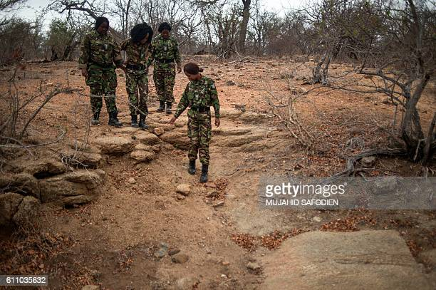 Female members of the antipoaching team Black Mamba go out on a routine patrol through a wildlife reserve on September 25 2016 in the Limpopo...