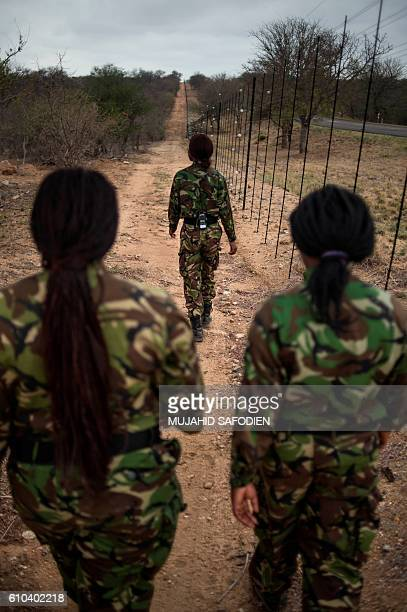Female members of the antipoaching team Black Mamba perform a routine patrol through a wildlife reserve on September 25 2016 in Hoedspruit in the...