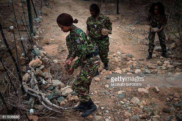 Female members of the antipoaching team Black Mamba perform a routine patrol through a wildlife reserve on September 25 2016 in the Limpopo province...