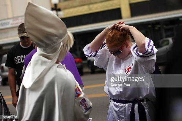 Female members of the Fraternal White Knights of the Ku Klux Klan prepare their robes before participating in the 11th Annual Nathan Bedford Forrest...