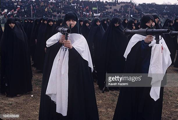 Female members of the Iranian Basiji in black chador hold rocket launchers on their shoulders in a Tehran rally during the Iran-Iraq War, 12th...