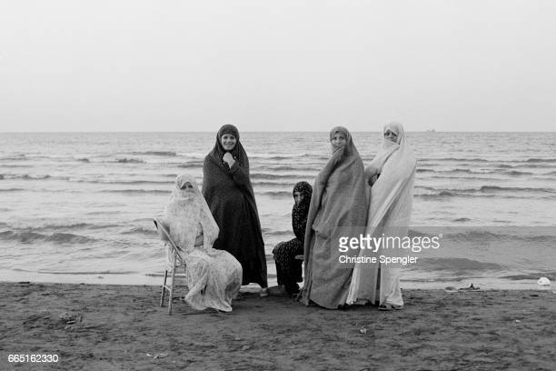 Female members of the Iranian Guardians of the Revolution corps pray together in their school in Tehran The Revolutionary Guard is charged with...