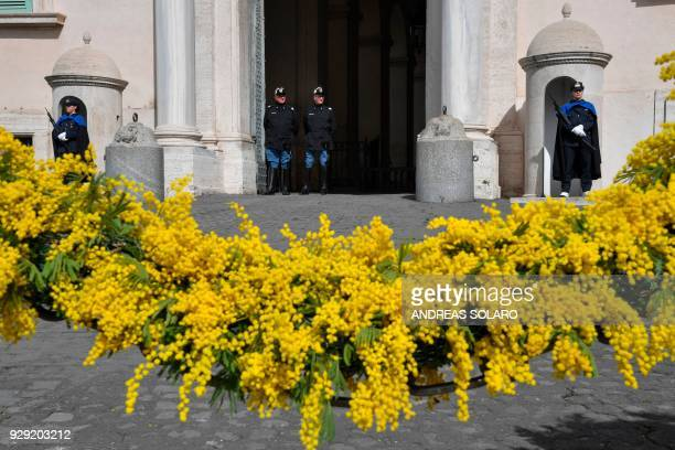 Female members of the Italian Police Honor Guard stand guard next to two male Corazzieri at the entrance of the Quirinale Palace the Italian...