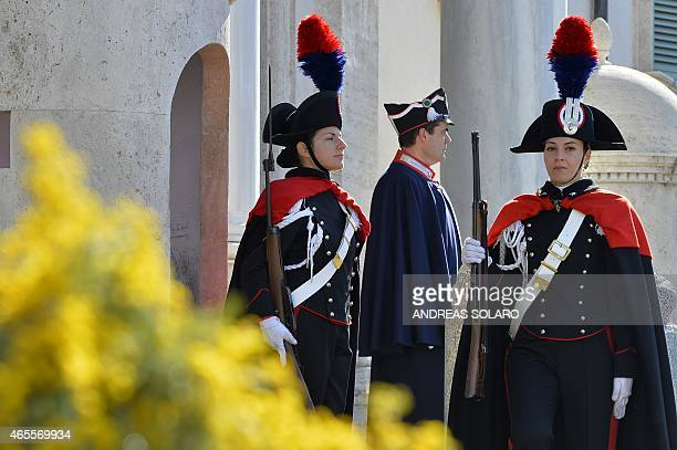 Female members of the Italian Presidential Honor Guard march during the changing of the guard at the entrance of the Quirinale Palace the Italian...