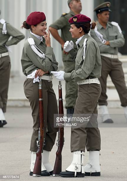 Female members of the military honor guard wait before the arrival of Egyptian Prime Minister Ibrahim Mahlab at TunisCarthage International airport...