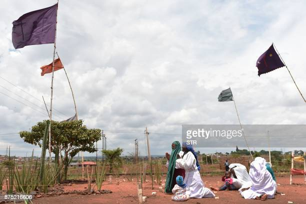 TOPSHOT Female members of the New Apostolic Church perform morning prayers on November 17 2017 at a shrine in Warren Park suburb of Zimbabwe's...