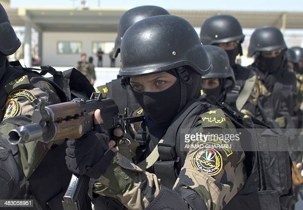 Female members of the Palestinian presidential guard take part in a training session in the West Bank city of Jericho on April 6 2014 AFP PHOTO/AHMAD...