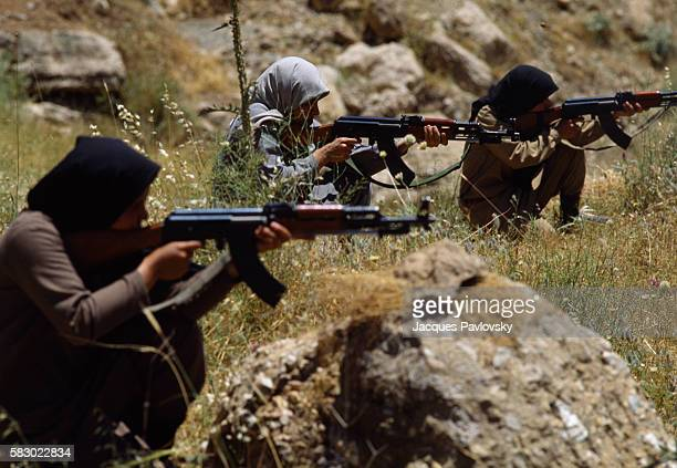 Female members of the People's Mujahiddins practice target shooting in the Iraqi mountains