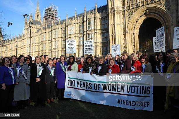 Female members of the Shadow Cabinet and Labour politicians stand on college green with a '100 Years of Women Voting' banner on February 6 2018 in...