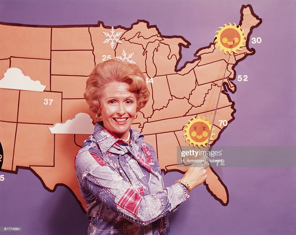 Female meteorologist standing in front of map of United States. (Photo by H. Armstrong Roberts/Retrofile/Getty Images) : Stock Photo
