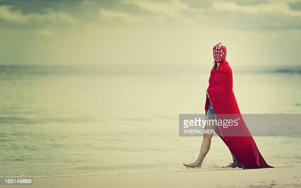 female mexican fighter walking on the beach