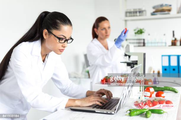 Female microbiologist making researches in laboratoty
