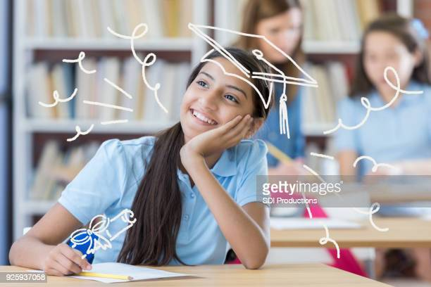 female middle school student daydreaming about her future - budding tween stock photos and pictures