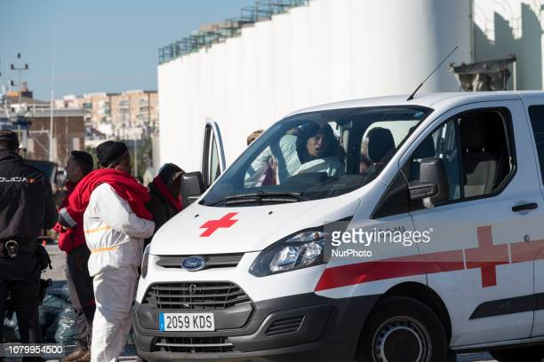 A female migrant gets into the Red cross van with some dificulties as she suffers from an injury on January 9 Malaga Southern Spain