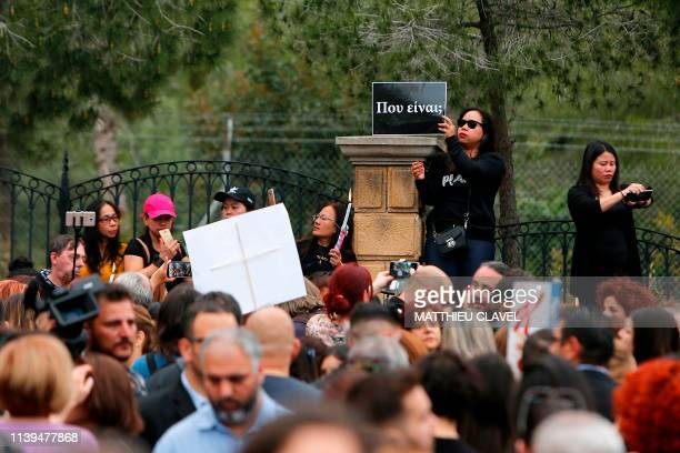 A female migrant worker holds a banner reading Where are you as protesters demonstrate in support of the victims of a suspected serial killer in...