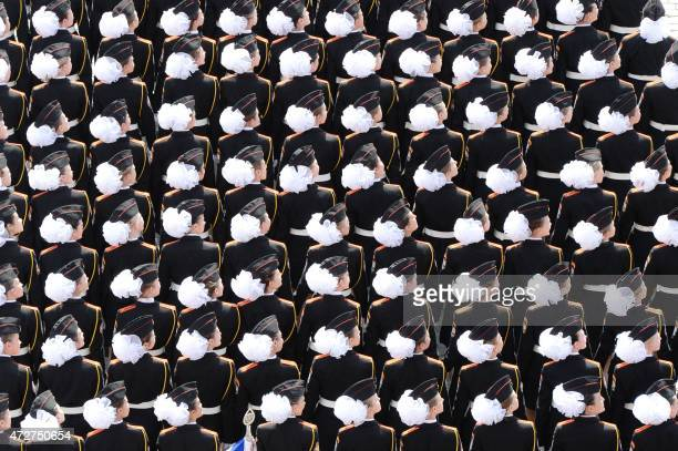 Female military cadets march through Red Square during the Victory Day military parade in Moscow on May 9 2015 Russian President Vladimir Putin...