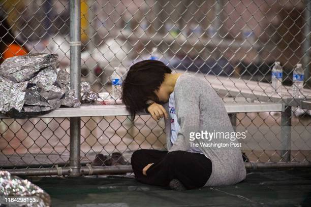 Female minor rests her head on a bench in the US Border Patrol Central Processing Center in McAllen, Texas on August 12, 2019. Border Patrol...