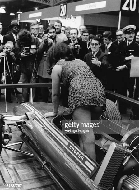 Female model climing in to Cooper F5000 at 1969 Racing Car show Creator Unknown
