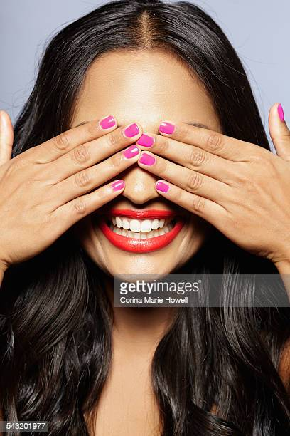 Female model covering eyes with hands