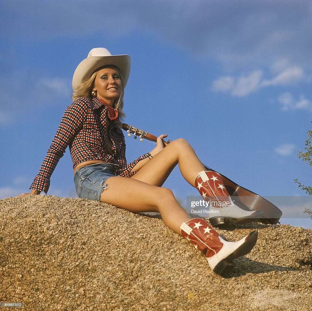 A Female Model Dressed In Country Music Style Wearing Cowboy Boots