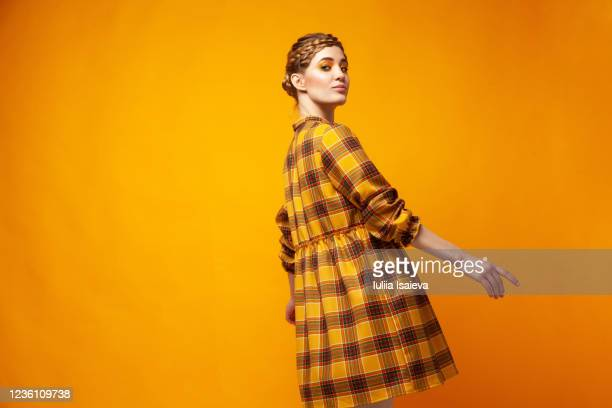 female model in checkered yellow dress - art modeling studio stock pictures, royalty-free photos & images
