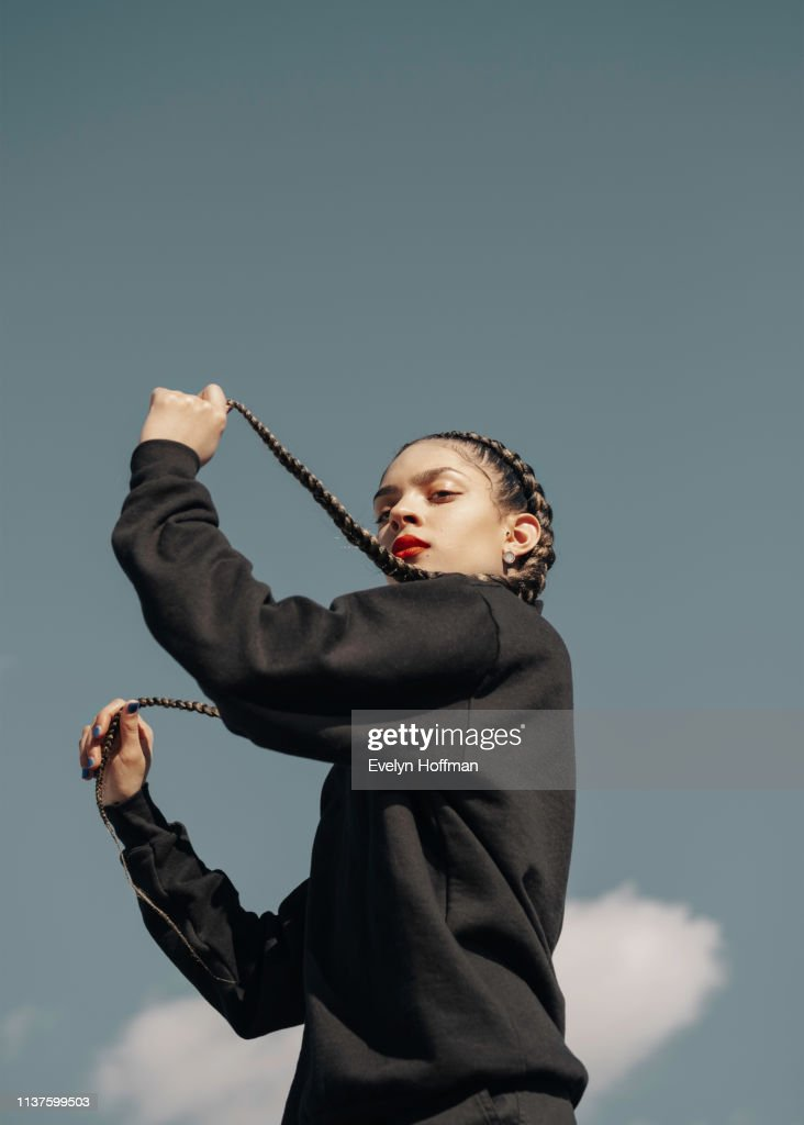 Female Model photographed against sky backdrop : Stock Photo