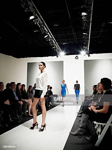 Female model posing at end of catwalk