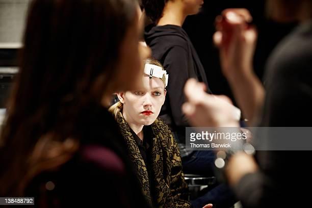 female model sitting backstage at fashion show - fashion show stock-fotos und bilder