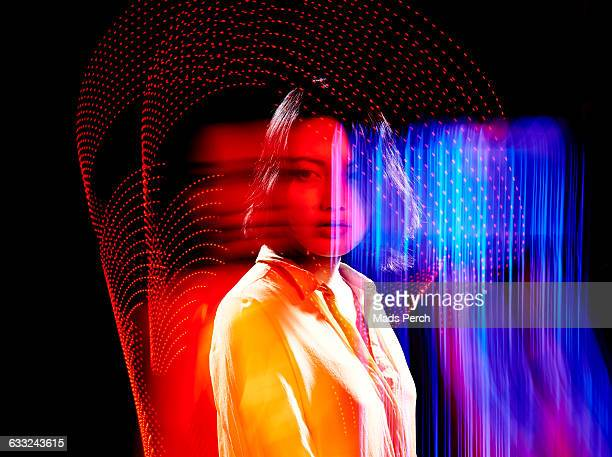 female model surrounded by colorful lights - yellow perch stock photos and pictures