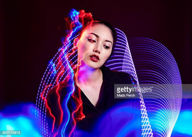 Female model surrounded by futuristic lighting