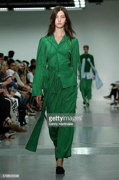 Female model walks the runway at the Craig Green show during The London Collections Men SS16 at Victoria House on June 12, 2015 in London, England.