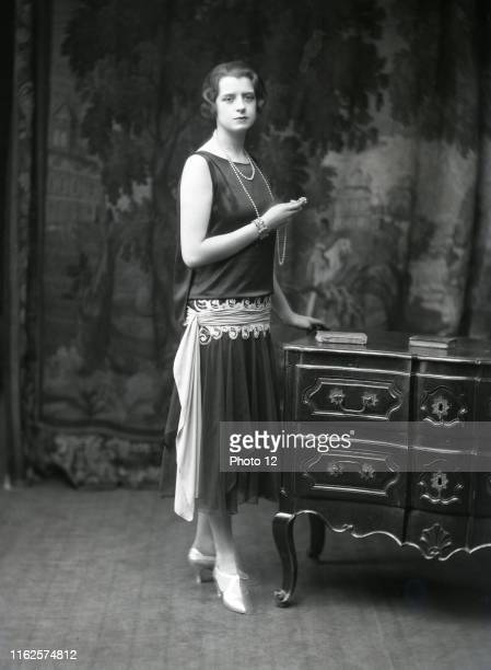 Female model wearing a dress designed by Charles Frederic Worth , English dressmaker who founded his own label and shop in Paris in 1858. He was the...