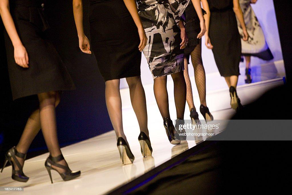 Female models at catwalk show : Stock Photo