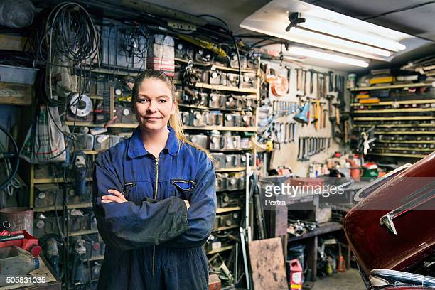 Female motor mechanic at the work shop.
