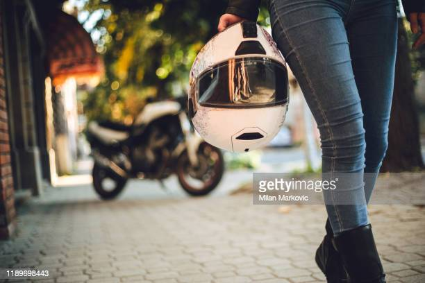 female motorcyclist is taking a break from traveling - biker jacket stock pictures, royalty-free photos & images